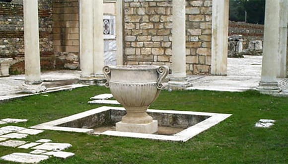 Ancient urn in a courtyard