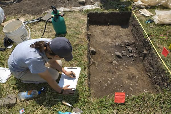 Cornell University graduate student Beth Ryan exposes a preserved Seneca feature, White Springs Site. Photograph by Jason Koski.